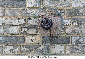 Domestic exhaust vent on a brick wall