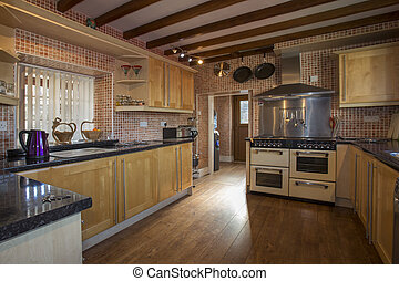 Domestic Kitchen - A fitted kitchen in a farmhouse in...