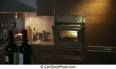 domestic kitchen with chicken in ov - food preparation:...