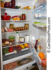 Domestic refrigerator full of a variety of foods