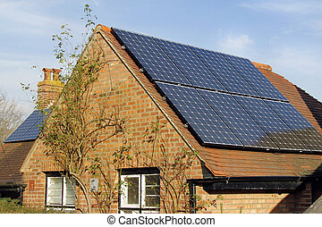 Domestic solar power - Domestic solar panels catching the...