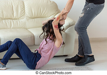 domestic violence, alcoholic and abuse concept - aggressive man grabbing his wife lying on the floor