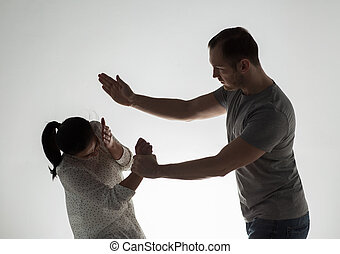 couple having fight and man slapping woman - domestic...