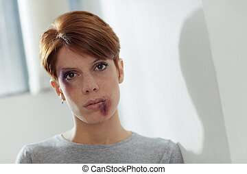 domestic violence - portrait of young caucasian woman being...