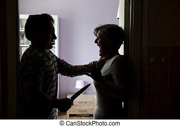 Domestic violence - Silhouette of mature couple fighting,...