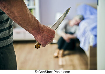 Domestic violence - Mature woman sitting on the floor is...