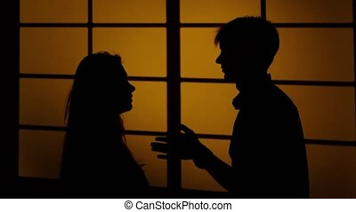 Domestic violence. Swearing and a fight. Silhouette. Close up