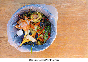 Domestic waste for compost from fruits and vegetables in garbage bin.