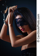 Dominating beauty in handcuffs - Fashion portrait of young...