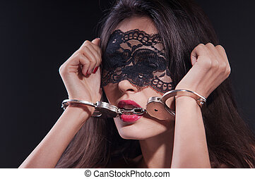 Dominating beauty in handcuffs