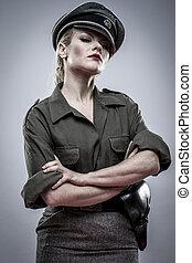 Dominatrix, German officer in World War II, reenactment, soldier beautiful woman