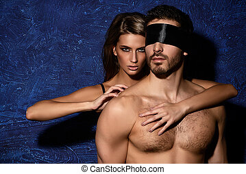 dominatrix - Sexual passionate couple play in love games.