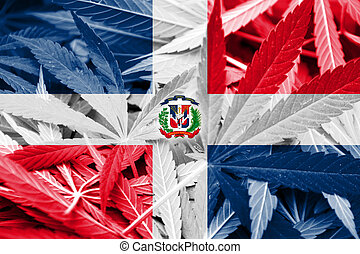 Dominican Republic Flag on cannabis background. Drug policy...