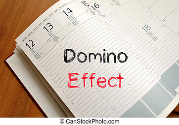 Domino effect concept on notebook