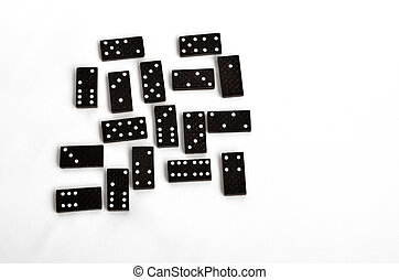 Domino effect concept scattered domino tiles on white...
