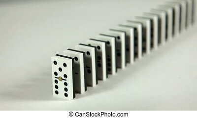 Hand starts domino chain reaction