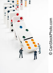 Domino Effect - Domino effect or chain reaction concept of...
