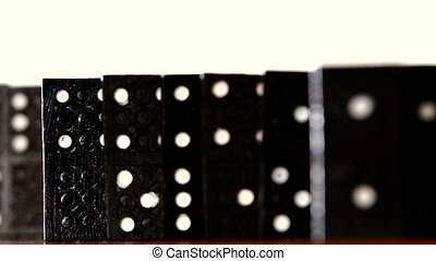 Domino, isolated on white, dynamic change of focus