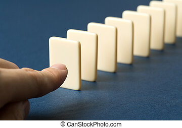 Domino with blue background, Concept of Cause or Teamwork
