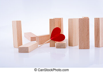Domino pieces and red heart shape