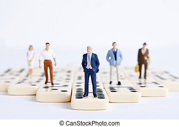 domino - some miniature people on domino cubes