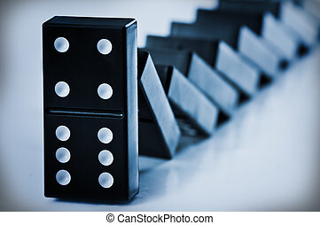 domino - falling domino concept close up