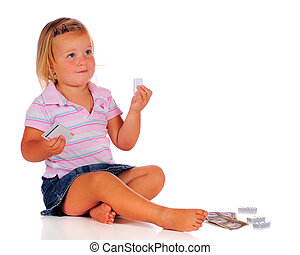 Dominoe Girl - A 3-year-old playing with a set of white ...