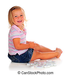 Dominoe Girl - A happy 2 year-old playing with white dominos...