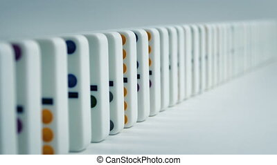 Dominoes Fall Down In Lines - Three Shots - Dominoes stacked...