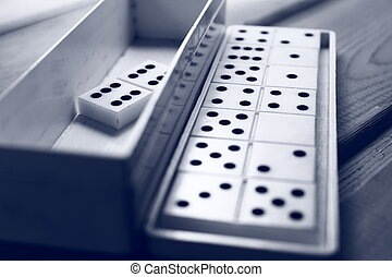 Dominoes game - Playing dominoes close-up on a wooden ...