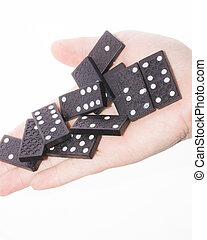 Dominoes in female hand on a white background