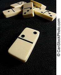 Dominoes - Macro photo of dominoes on black background