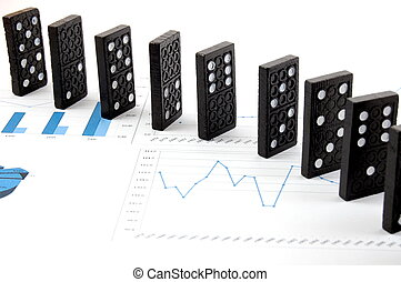 dominoes on chart - some domino stones on a blue business ...