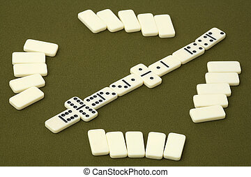 Dominoes - white dice on a green background