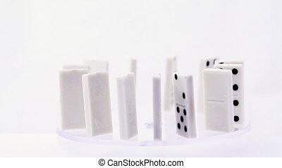 Dominoes with dots rotate standing in circle , then someone pushes one and consistently falling all