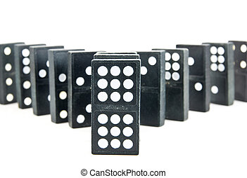 A row of dominoes splitting into two rows isolated against a white background