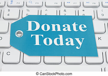 Donate Today message on a gift tag on gray keyboard
