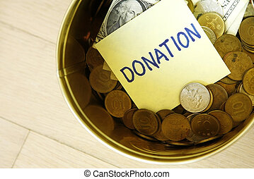 Donation Box - Donation in tin can with coins and one...
