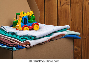 Donation box with children's things and toys. Help poor. Case full of clothing for poor families. Sharity social activity.