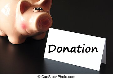donation or donate concept with piggy bank on black ...