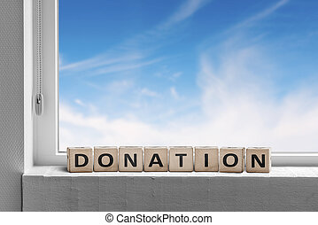 Donation sign standing in a window