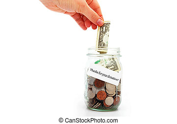 Donation thanks - hand putting a dollar into a donation jar...