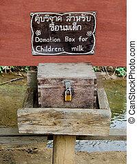 Donation wooden box for childrens milk