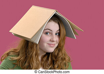 Done Studying - Girl with her book on her head instead of ...
