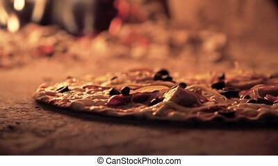 Done to a Turn - Extreme close up of pizza bubbling in the...