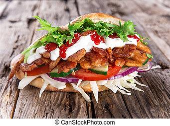 Doner Kebab - grilled meat, bread and vegetables