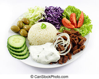 Doner with cucumber, tomatoes, beef, red cabbage and salad.