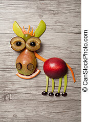 Donkey made with fruits on wooden background