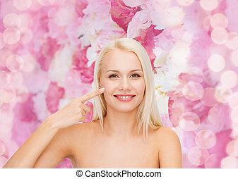 donna aguzzando, lei, guancia, giovane, sorridente