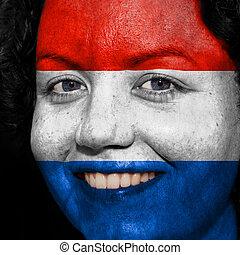 donna, con, bandiera, dipinto, su, lei, faccia, mostrare, paesi bassi, sostegno